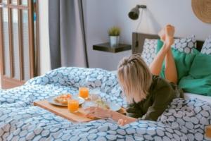 A woman having breakfast in bed